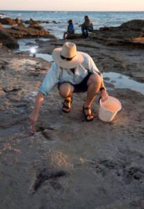 Dr Steve Salisbury - UQ Dino Lab carefully cleans some of theropod tracks st Minyirr prior to documenting them