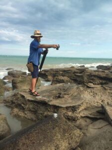Dr Steve Salisbury photographing some of the theropod tracks at Minyirr