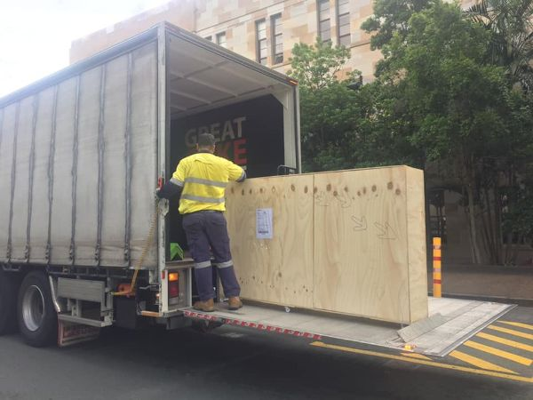 the dinosaur tracks box being loaded into the truck