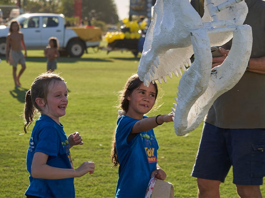 Kids interacting with dinosaur puppet - photo credit Don Bacon